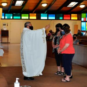 """""""priest blessing retirees at mass"""""""